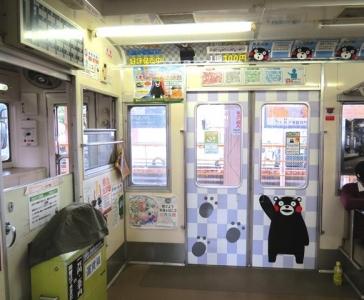 熊本電鉄ドア内側くまモン
